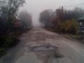 Исады-Улица Центральная в туманный день